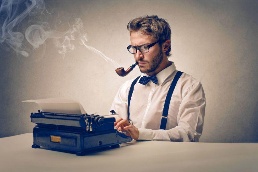 Парень с трубкой и печатной машинкой