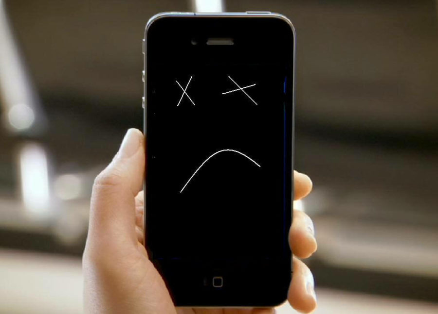 Телефон с грустным смайлом