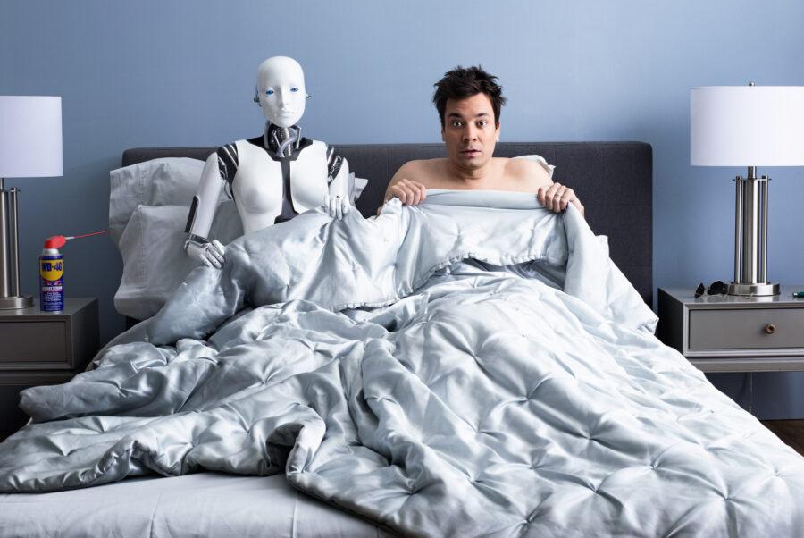 парень в постели с роботом